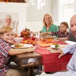 Family eating Premiala turkey dinner